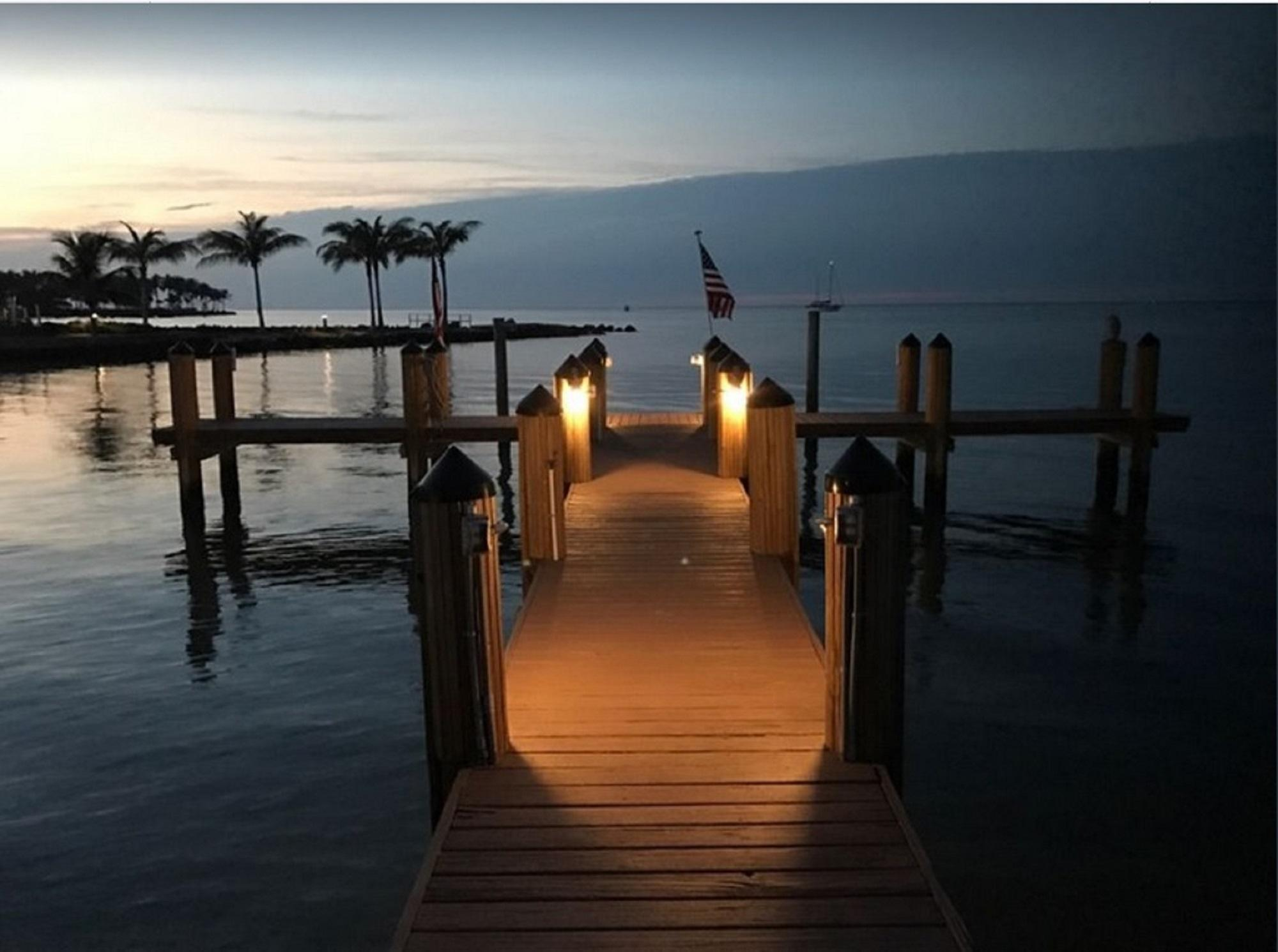 Dock At Sundown. Night Fishing Or Watch Star Sky