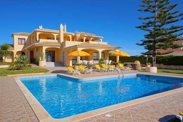Large terrace overlooks the pool with sea views